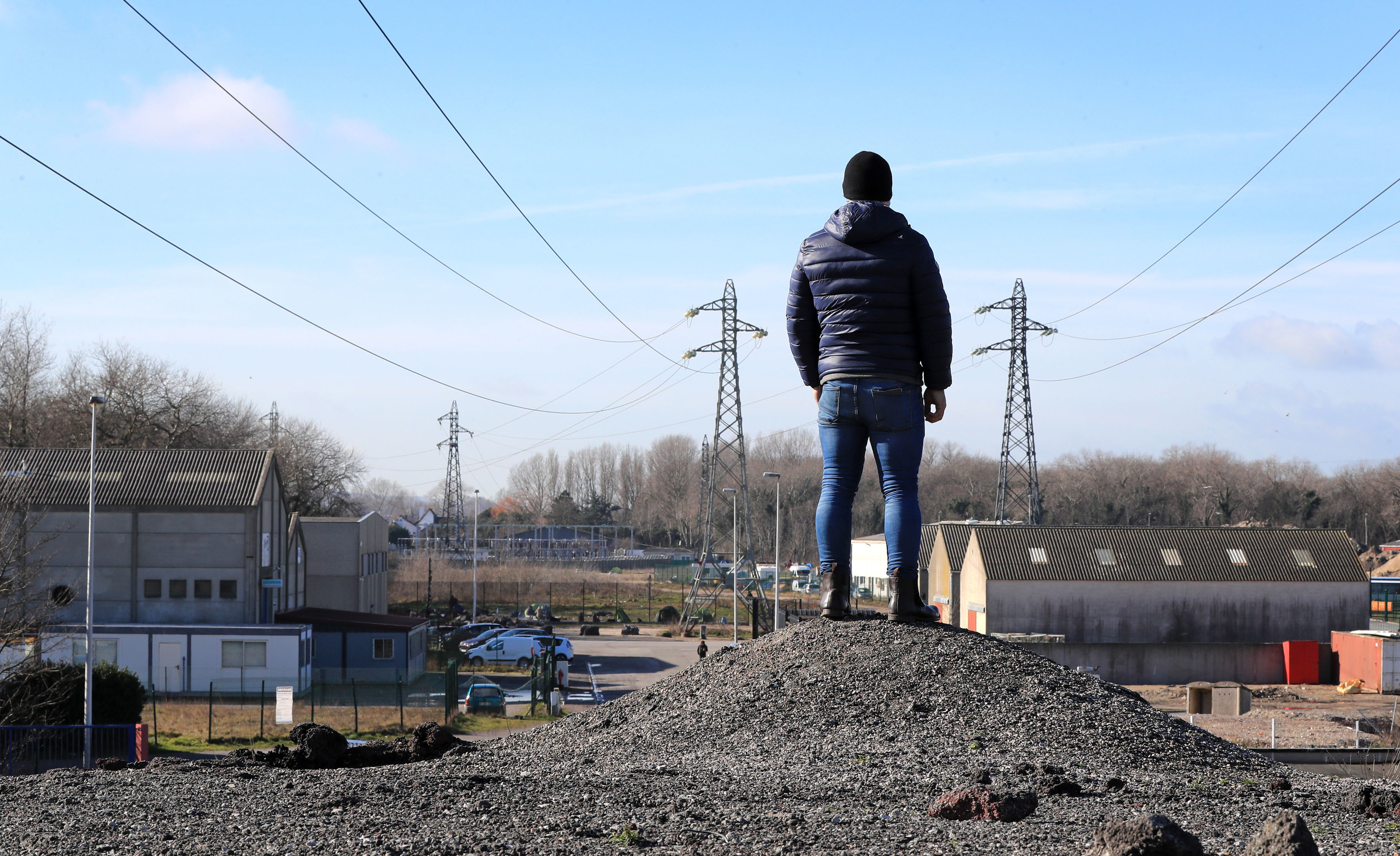 Ali from Iran, who lives in a tented camp in Calais, France