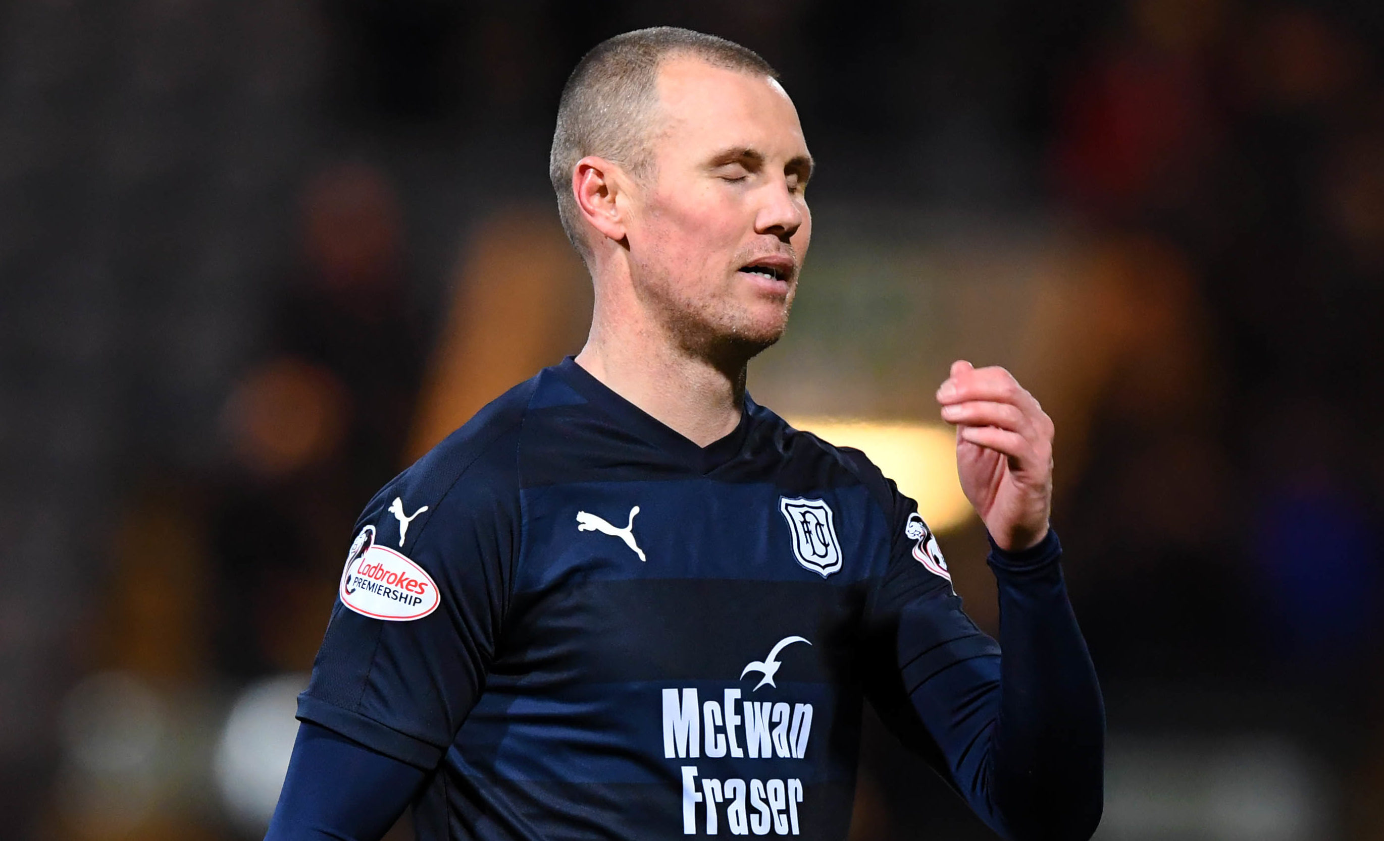 Dundee's Kenny Miller looks dejected at full-time (SNS Group / Gary Hutchison)