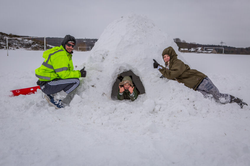 Tyler Bray (7) in igloo, Phillip Bray (27) and partner Amie Dorman (21) have had a great time building an igloo in Glenrothes