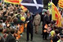 Tony Blair is greeted by crowds in Edinburgh in 1997 following the government's plan for a Scottish parliament.