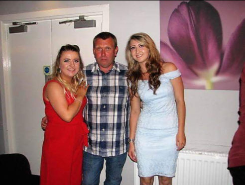 Keith Adams with daughters  Sarah (right) and Gayle (left) is the one in red it was taken at Gayles engagement party September 2017
