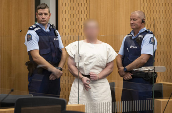 The man charged in relation to the Christchurch massacre in the dock
