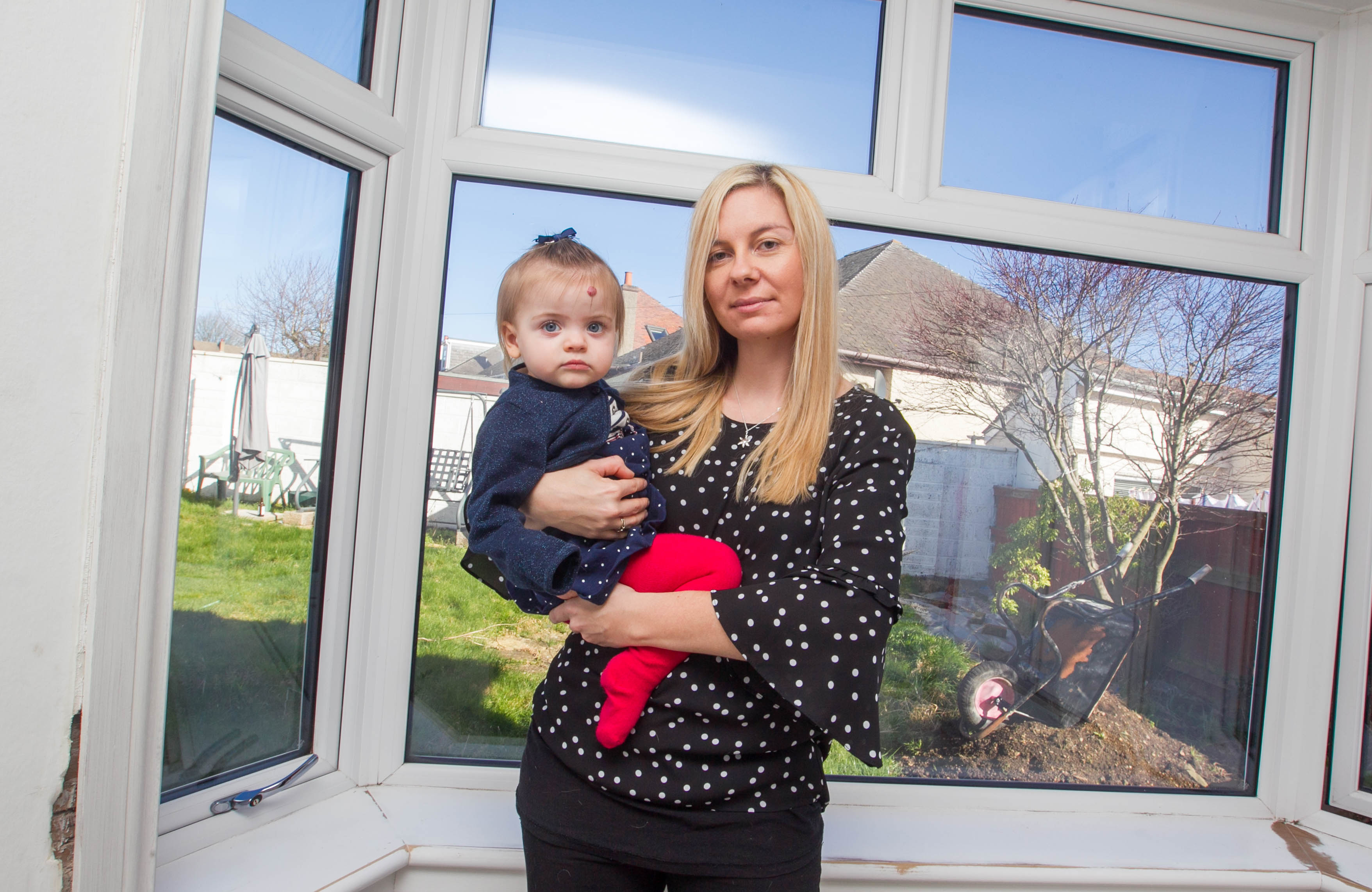 Jen Baillie has had problems with their new windows. Jen with daughter Lily-Rose.