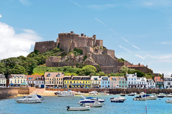 The magnificent Mont Orgueil Castle towers over Gorey Bay on Jersey