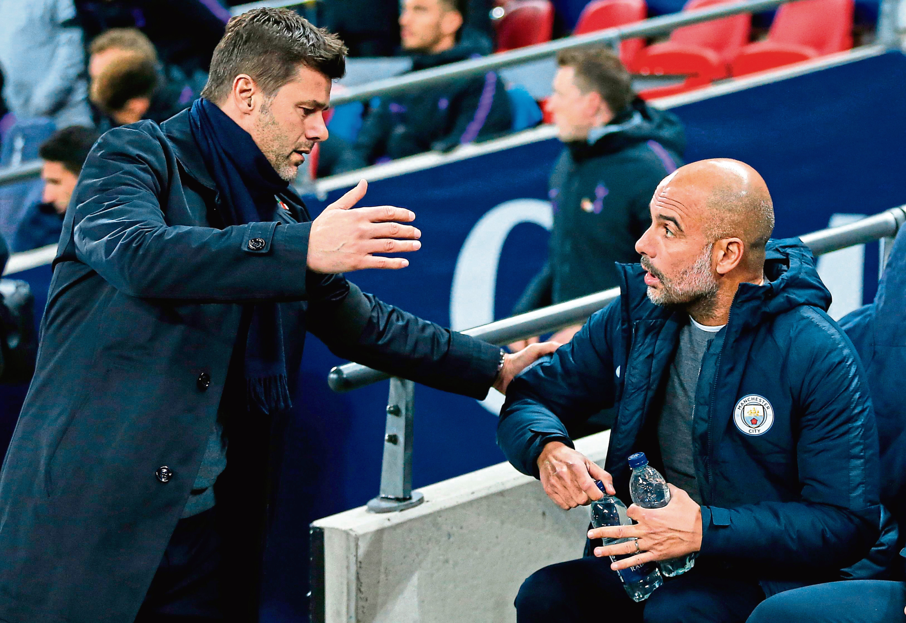 x Tottenham Hotspur's Argentinian head coach Mauricio Pochettino (L) greets Manchester City's Spanish manager Pep Guardiola ahead of the English Premier League football match between Tottenham Hotspur and Manchester City at Wembley Stadium in London, on October 29, 2018. (Photo by Ian KINGTON / IKIMAGES / AFP) / RESTRICTED TO EDITORIAL USE. No use with unauthorized audio, video, data, fixture lists, club/league logos or 'live' services. Online in-match use limited to 45 images, no video emulation. No use in betting, games or single club/league/player publications.        (Photo credit should read IAN KINGTON/AFP/Getty Images)