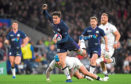 Sam Johnson of Scotland evades Jack Nowell of England as he breaks away to score their sixth try
