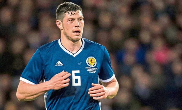 Scott McKenna in action for Scotland