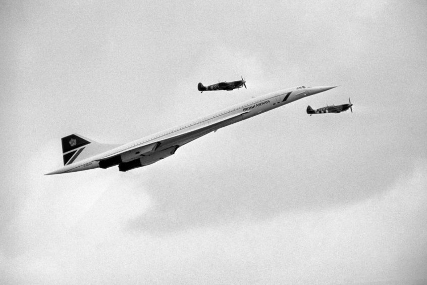 Concorde shadowed by two Second World War Spitfires as it arrives to make passes over the Biggin Hill Air Show, 1986