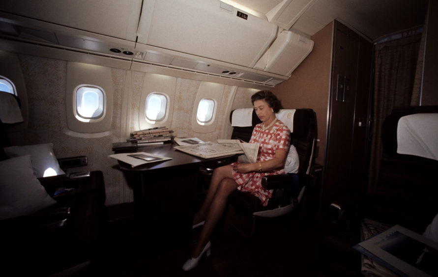 The Queen during her flight home on Concorde from Bridgetown, Barbados, after her Silver Jubilee tour of Canada and the West Indies, 1977
