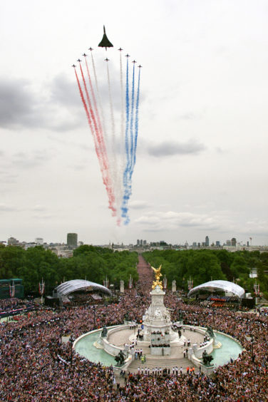 Concorde and the Red Arrows above The Mall as part of the celebration to mark the Golden Jubilee of Queen Elizabeth II, 2002