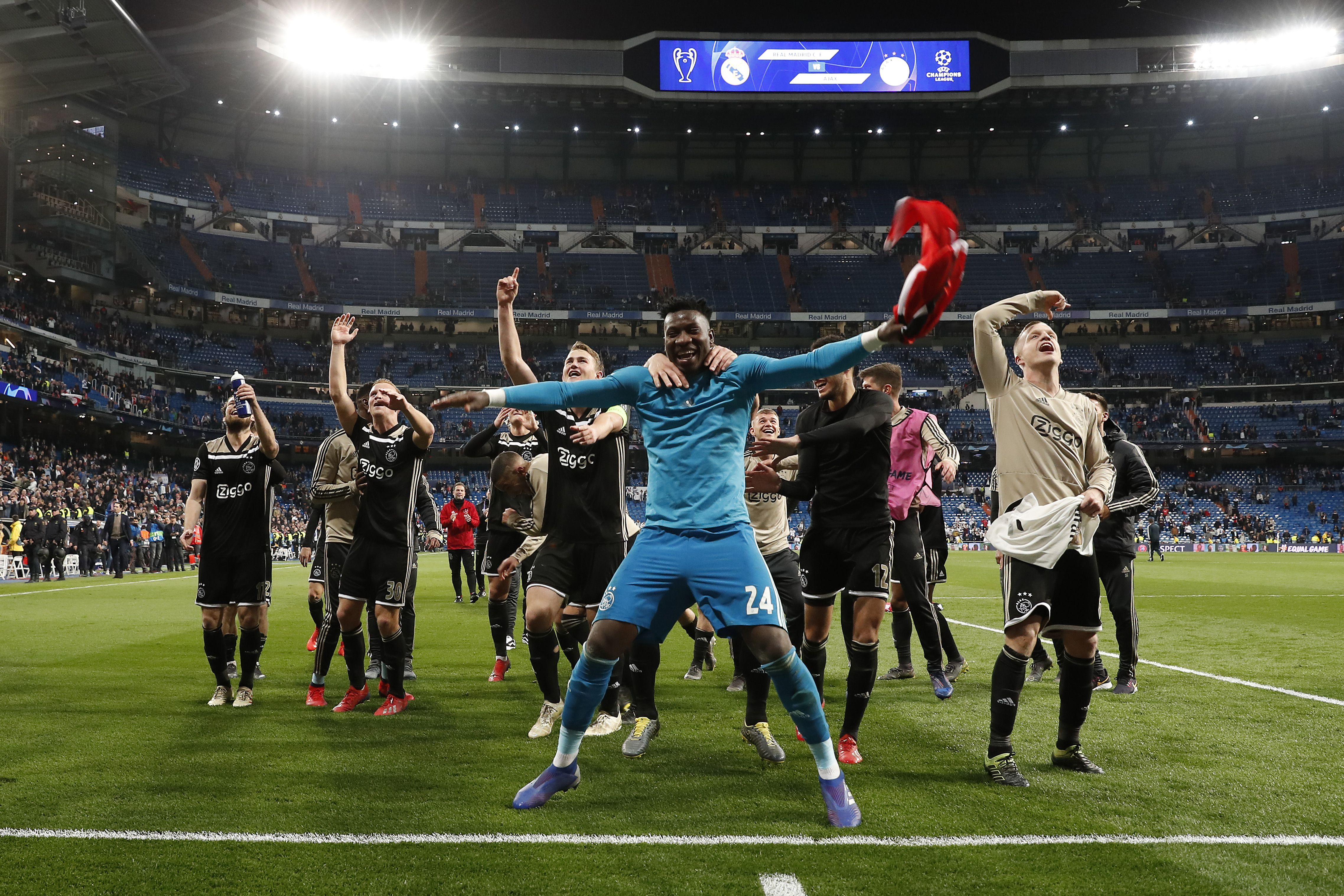 Ajax players celebrate a famous win
