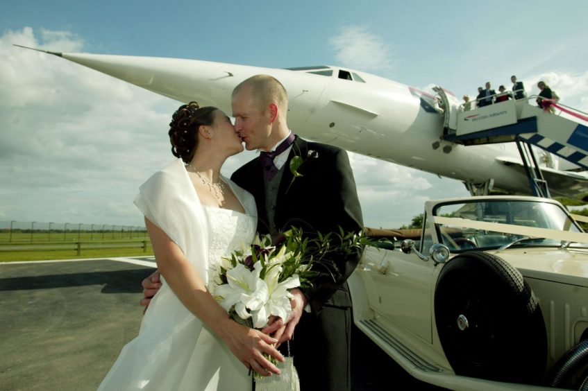 Ian and Helen McNab from Macclesfield, Cheshire, after they became the first couple to marry on Concorde since it was decommissioned at Manchester Airport