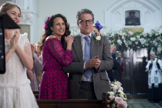 Behind the scenes of Andie Macdowell and Hugh Grant during the filming of One Red Nose Day and a Wedding