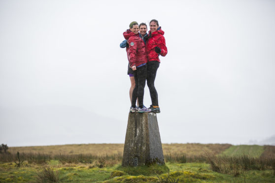 Jamie Aarons, Alex Berry and Jenny Allen who are runners are doing a trig point challenge on 6 April