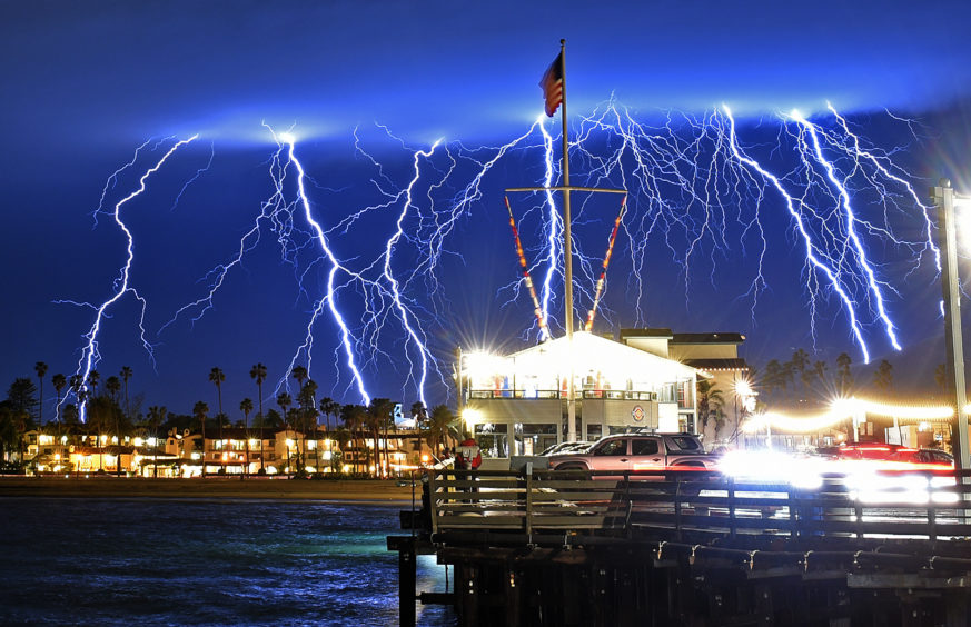 A time exposure captures a series of lightning strikes above Stearns Wharf in Santa Barbara
