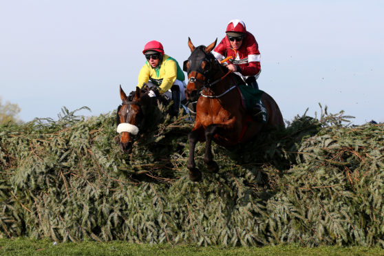 Davy Russell riding Tiger Roll clears the final fence as he races to victory during the Randox Health Grand National