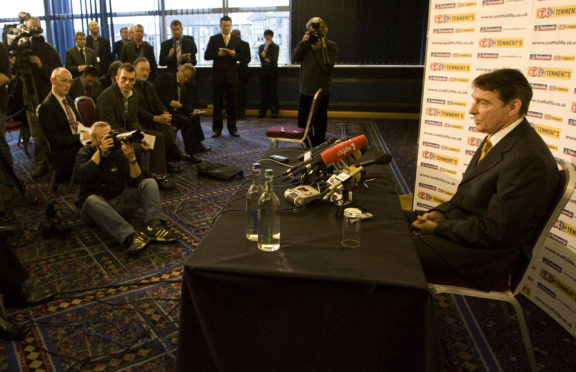 Gordon Smith in front of the media after George Burley was sacked as Scotland boss