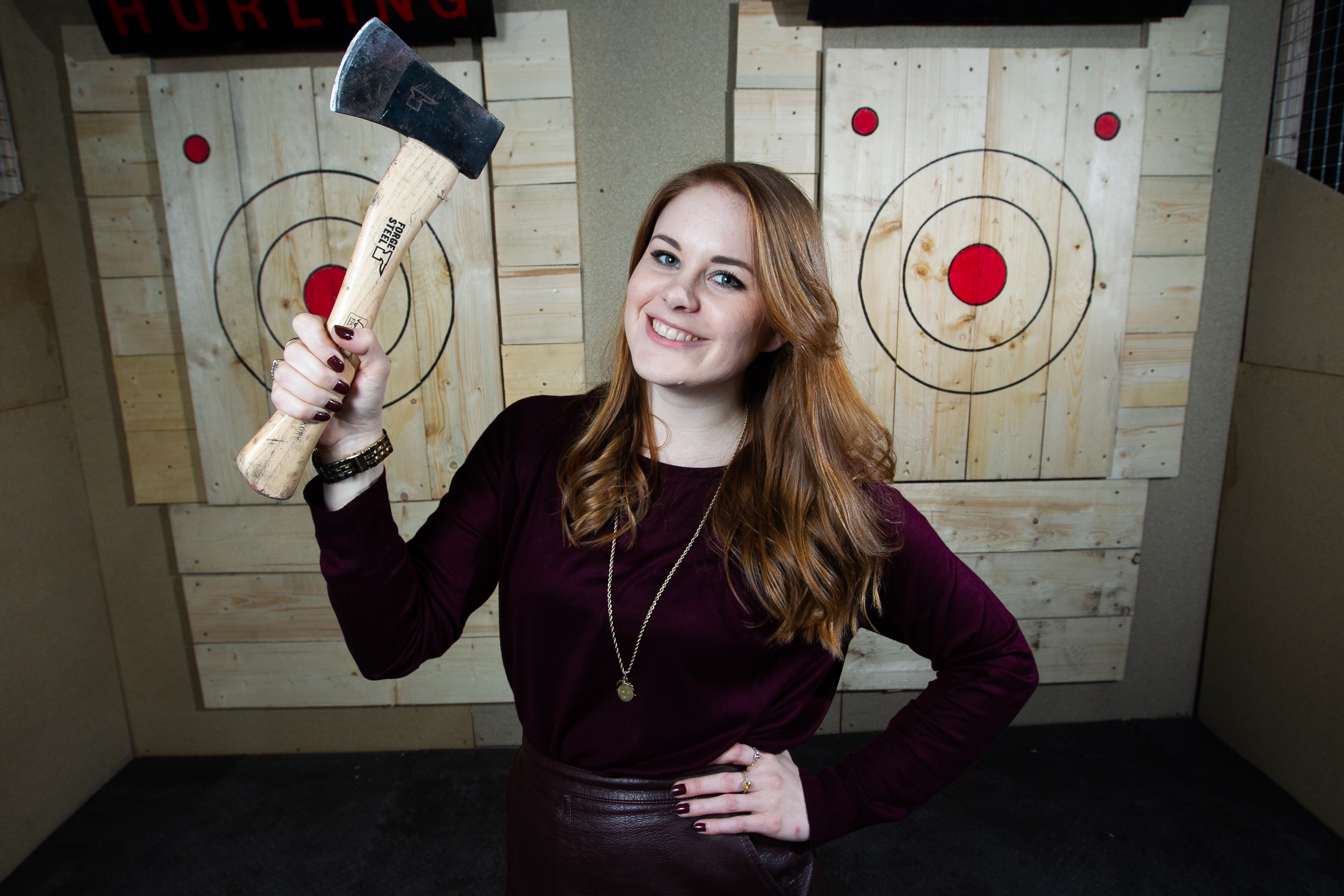 Sunday Post reporter Alice Hinds having a go at axe throwing