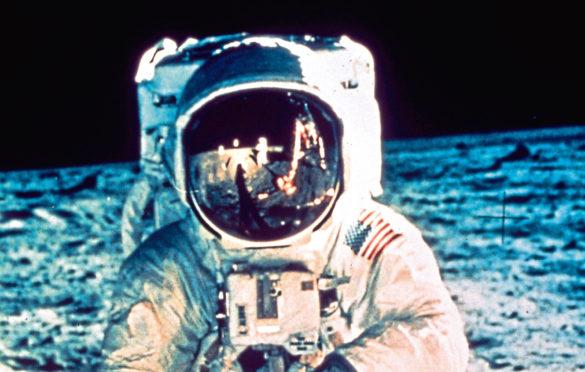 Neil Armstrong, seen reflected in Buzz Aldrin's visor