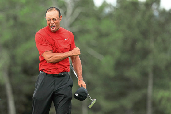 Tiger Woods celebrates his stunning victory at Augusta last Sunday