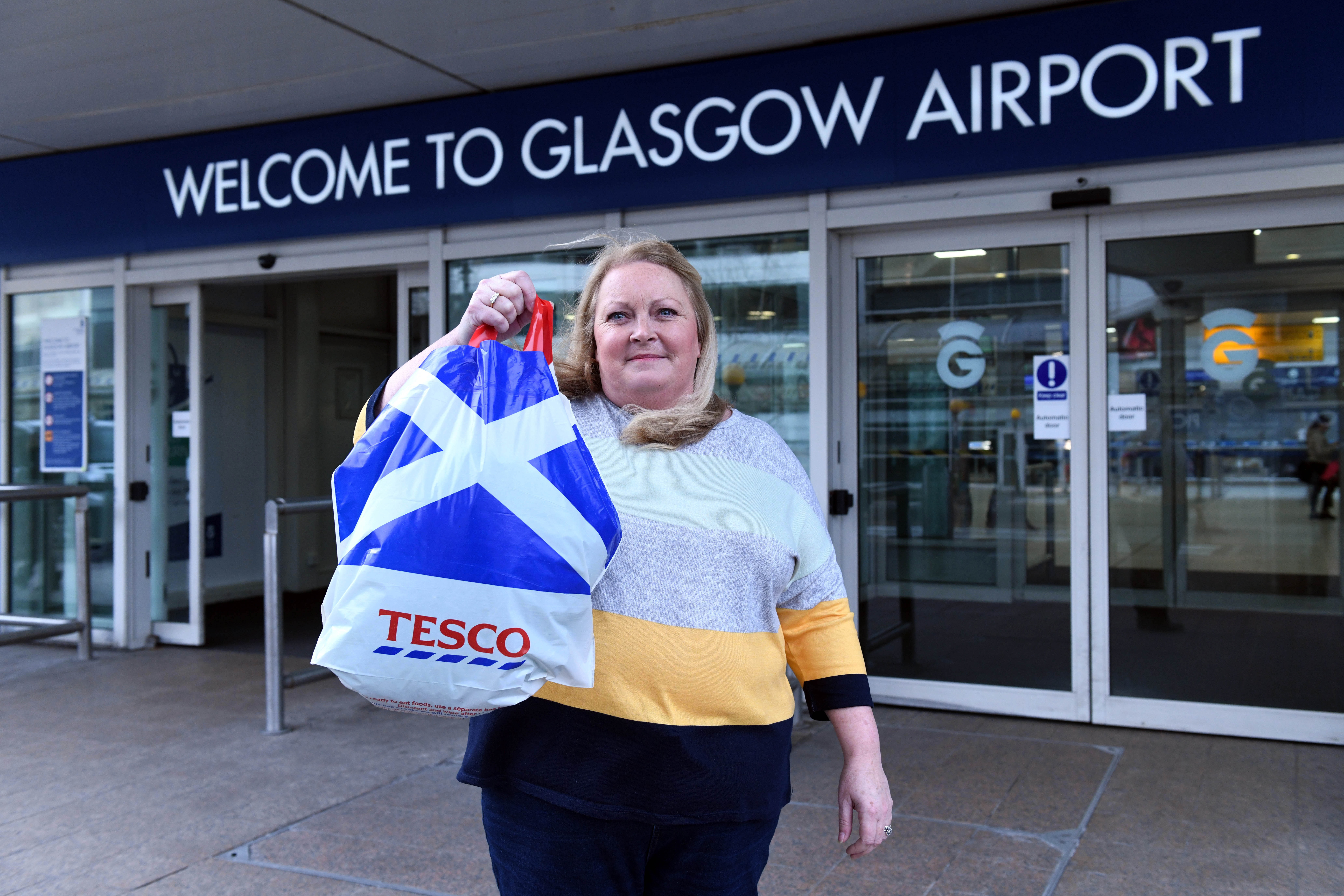 Clare Anderson had to use a Tesco carrier bag instead of her specially purchased case