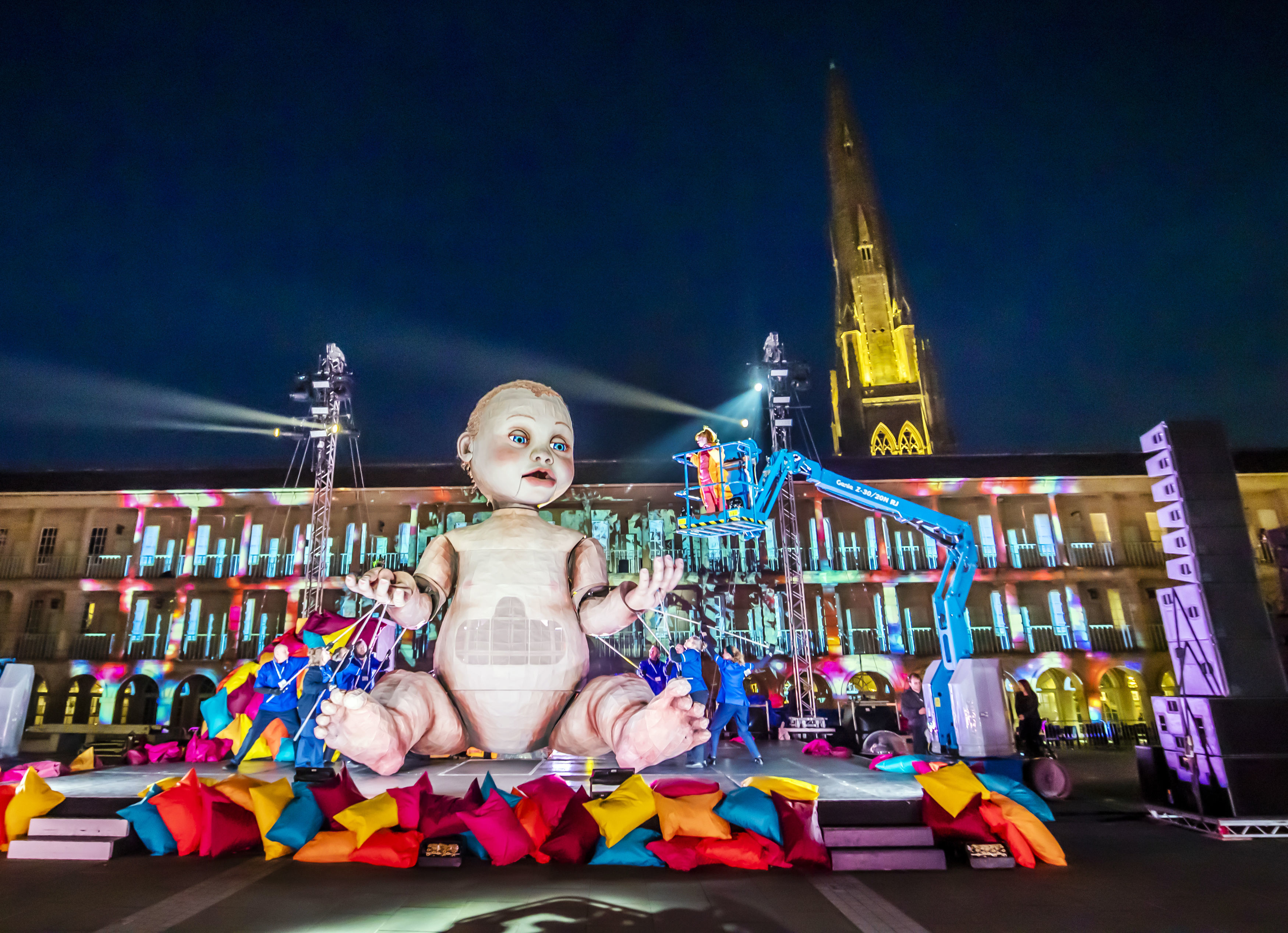 A giant mechanical baby, which stands taller than a double-decker bus and takes nine people to operate, forms the centrepiece of an outdoor theatre production, Zara, at the Piece Hall in Halifax, Yorkshire. The performance puts learning-disabled parents and artists at its heart and tells the story of a mother's fight for her children