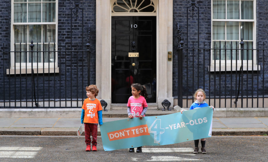 Alex Harrison (left), Safa Patel and Isla Tart outside 10 Downing Street as they prepare to deliver a petition calling for an end to tests in Reception class