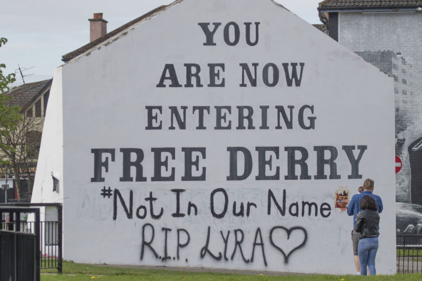 A message of condolence for 29-year-old journalist Lyra McKee graffittied on to the Free Derry Corner
