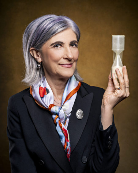 ITALY: Prof Raffaella Ocone OBE FReng FRSE, Heriot-Watt University, the first female professor of chemical engineering in Scotland, working with the design and operation of industrial processes, such as oil refining.  Raffaella is holding a small-scale model of a conical hopper, which is used to analyse the flowability of powders
