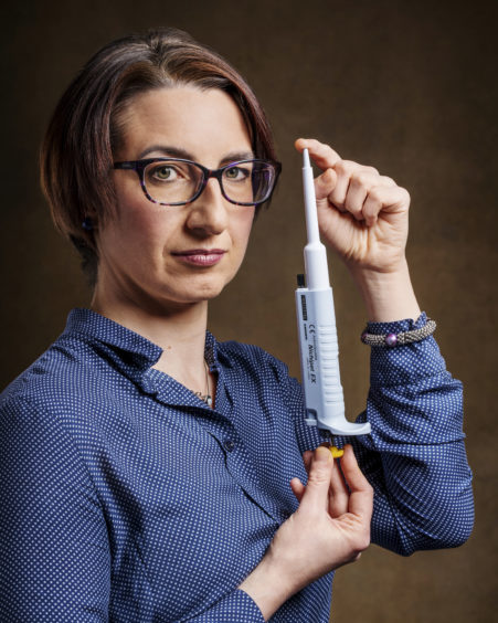ITALY: Dr Silvia Paracchini FRSE, School of Medicine, University of St Andrews, a human geneticist focusing on the genetic basis of dyslexia.  She is holding a single-channel pipette, which she likens to an extension of her arm as her work consists of mixing tiny, very precise volumes of different reagents