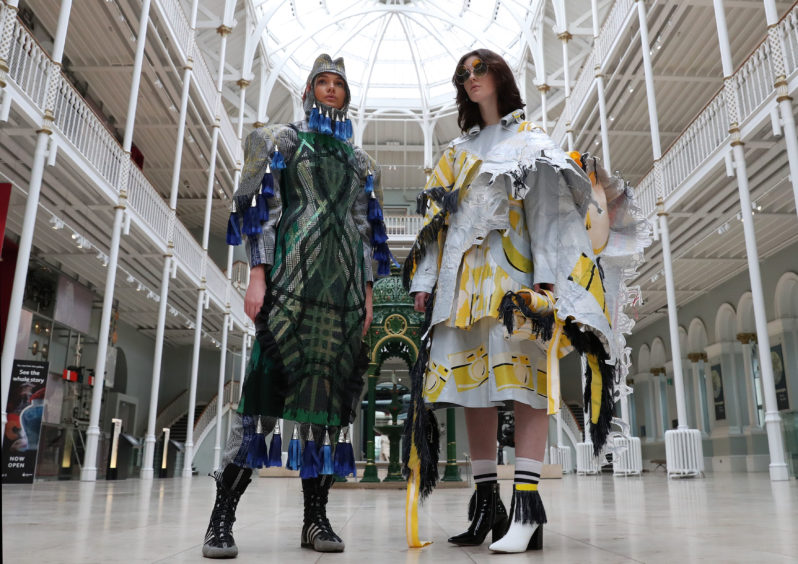 A creation by Rosie Baird using Scottish motifs, left, and a design by Ellie Thomson made from plastic bags are modelled at the National Museum in Edinburgh