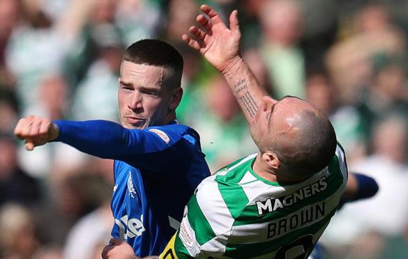 Rangers' Ryan Kent (left) and Celtic's Scott Brown clash