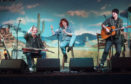 Jessie Buckley, centre, stars as Rose, the Glasgow girl dreaming of Nashville stardom superstardom