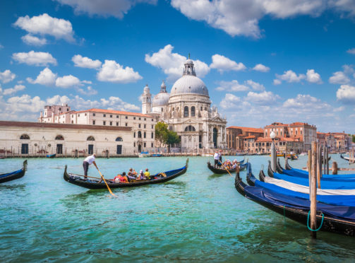 The Basilica  di Santa Maria makes a stunning backdrop to Venice's famous canals