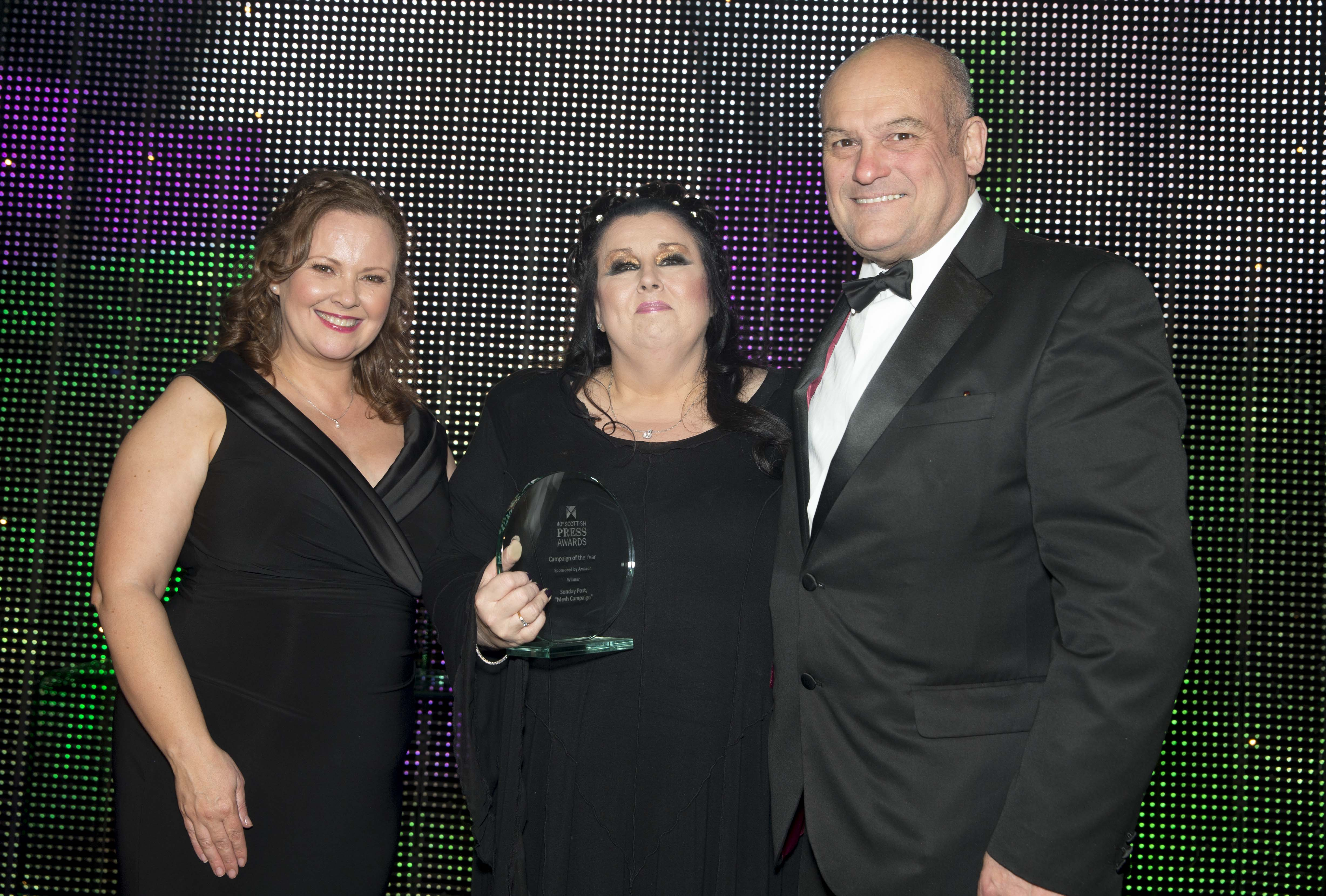 Marion Scott (centre) with her award for Campaign of the Year
