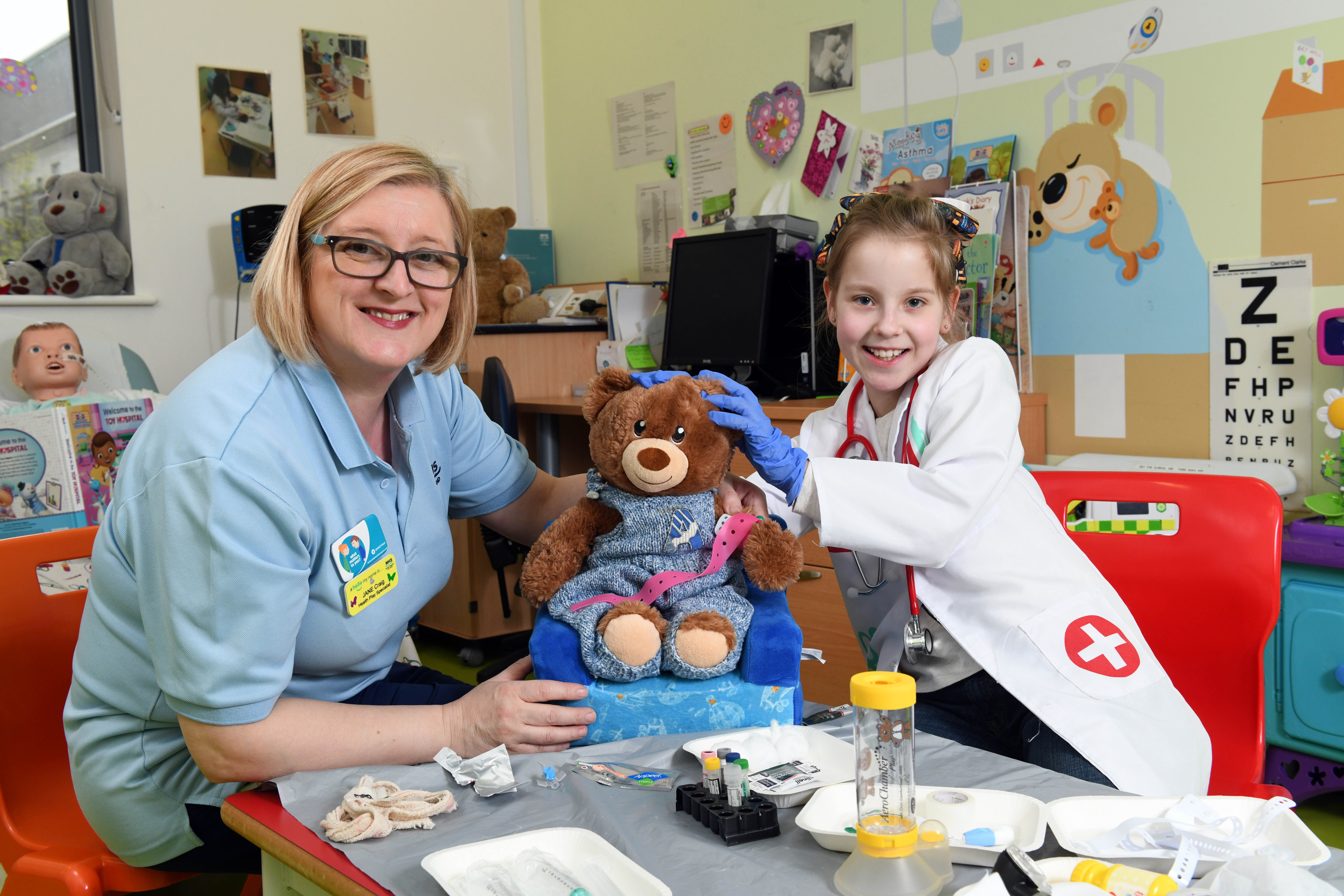 Pictured is Hayley Pollock aged 10 with nurse Jane Craig in the Teddy Hospital at the Royal hospital for sick children in Glasgow.