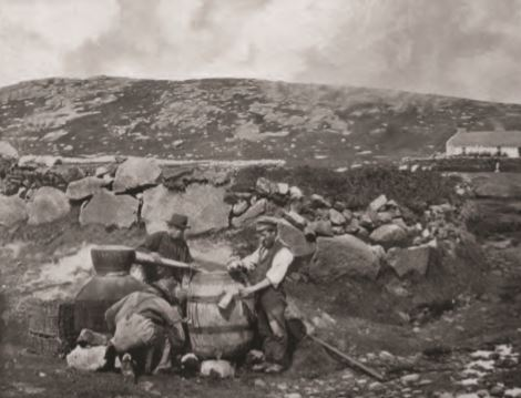The famous image of the MacAlister's illicit still, taken in Donegal in 1902. A similar set up would have been seen on Arran, but in a more secluded setting.