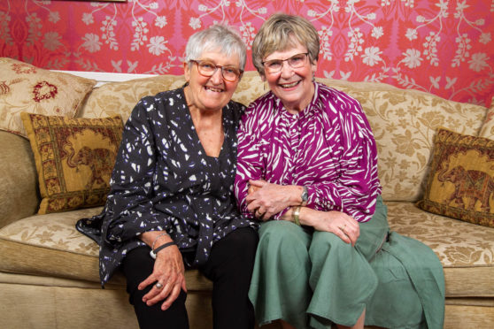 Terry Cunningham (purple) and her friend Rosemary have been friends for years.