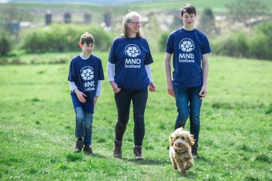 Widow Karen Corrie with her sons Euan (9) and Jamie (15) and dog Sula