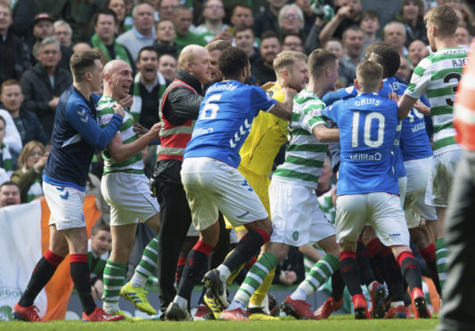 Celtic and Rangers players clash