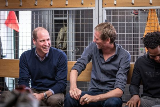 """The Duke of Cambridge (left) speaking with Peter Crouch (centre) and Danny Rose during the BBC One documentary a A Royal Team Talk.The Duke of Cambridge described how his experiences as an air ambulance pilot left him feeling death was """"just around the door""""."""