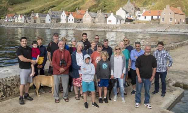 Given the slip? Crovie residents on the village pier
