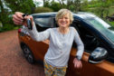 Corinne Hutton holds the keys to her Suzuki Vitari in her new hands  before going for a first spin