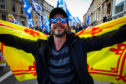 An independence supporter takes part in the march