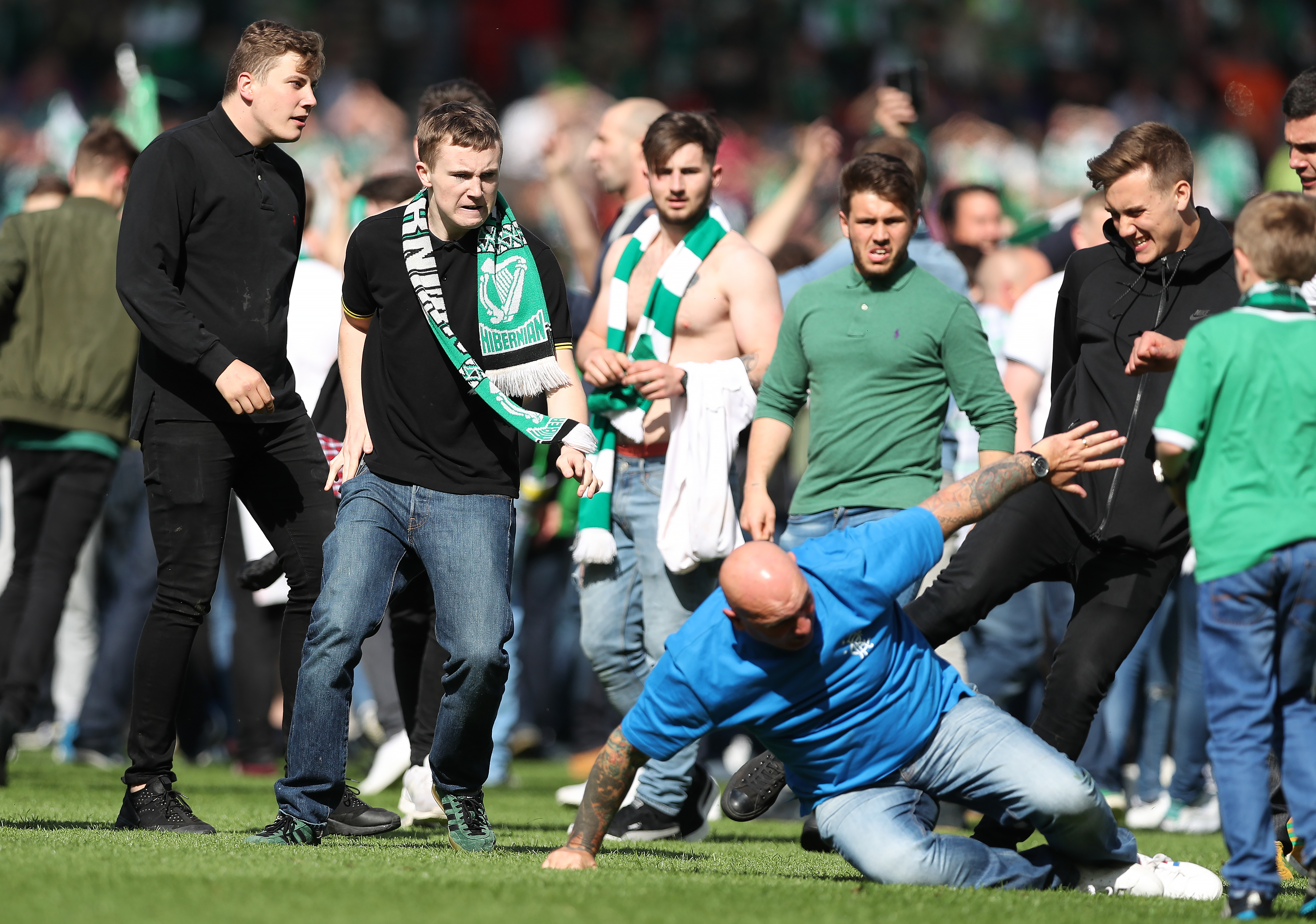 Hibernian and Rangers supporters clash on Hampden Park pitch following the 2016 Scottish Cup Final