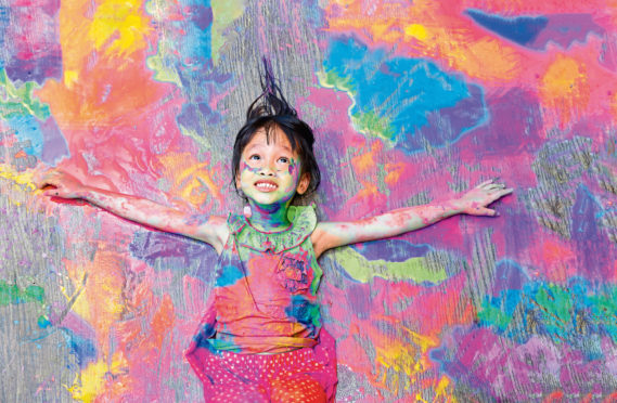 Posed picture of a girl covered in paint. Colours were extracted from everything including bones and even snails