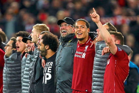 Liverpool boss Jurgen Klopp celebrates with his players and staff