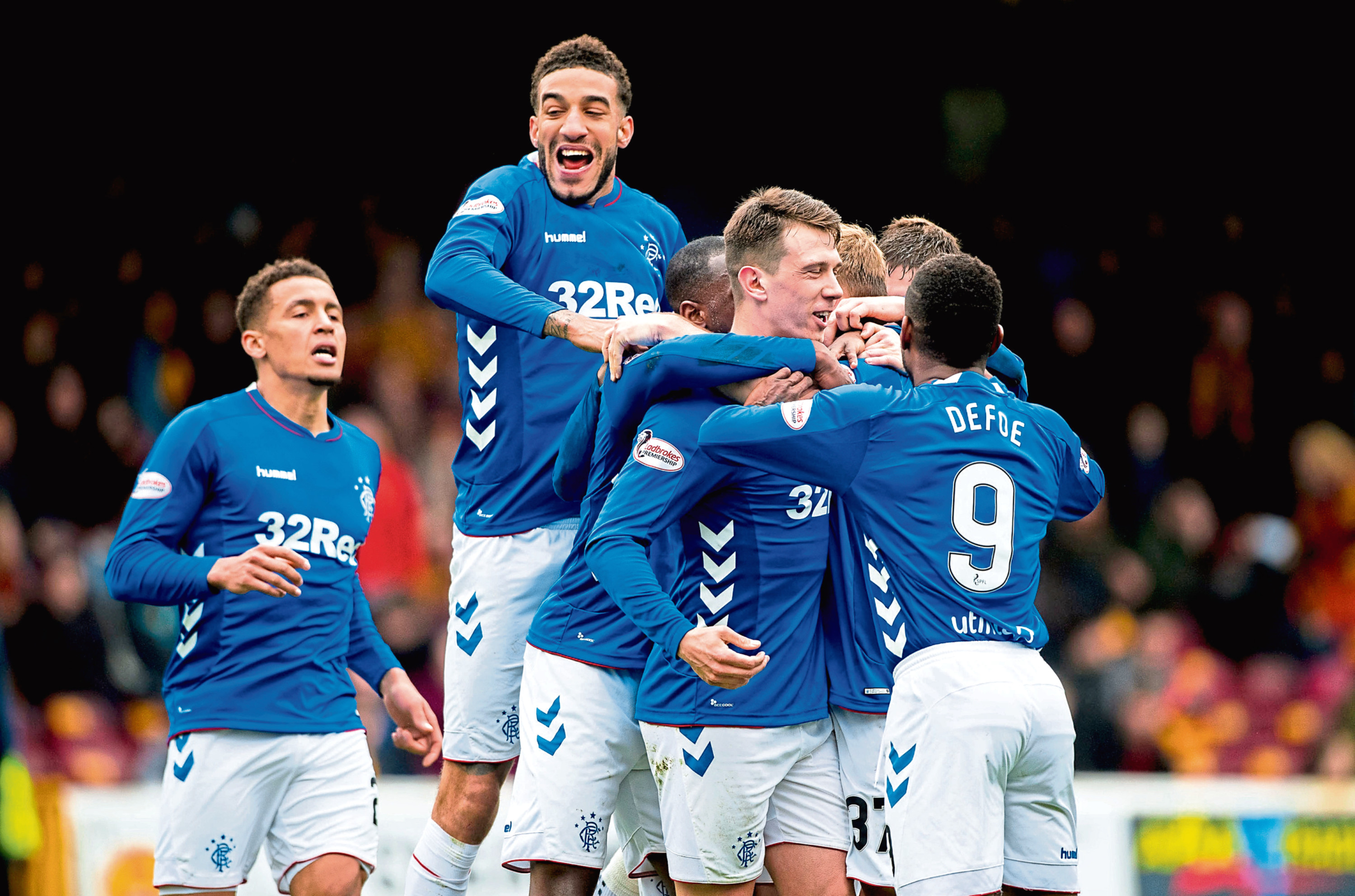 Connor Goldson joins his Rangers team-mates for a goal celebration