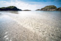 Iona, Scotland - the amazingly clear perfect shallow waters of Port Ban beach and bay.