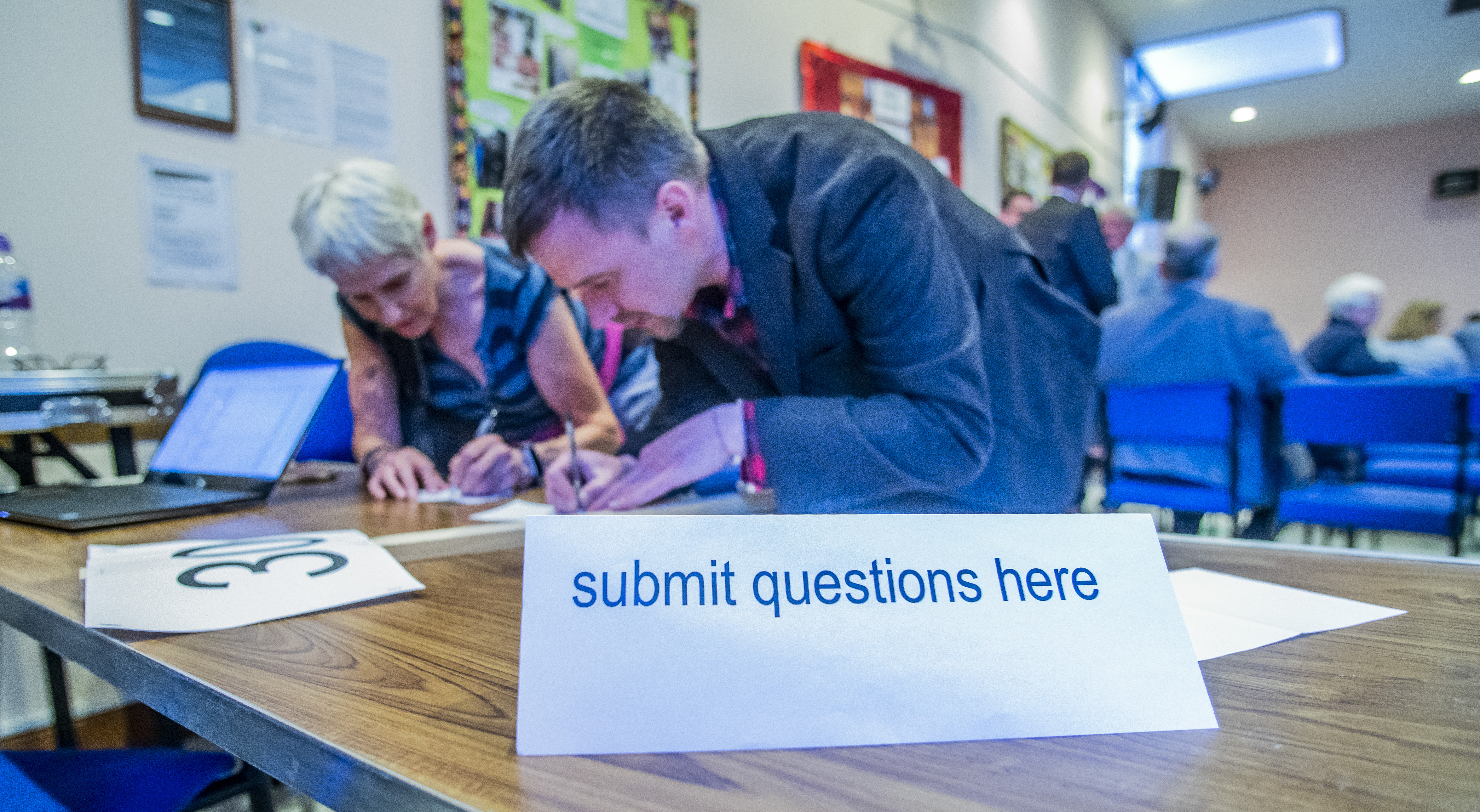 Organisers collate the questions asked by the audience at a hustings in Livingston